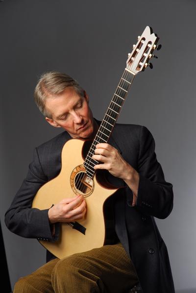 john stowell plays guitar